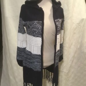 Woman's Almost Famous Long Sweater with Fringe.